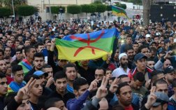 The Berber flag during the mass uprisings in Morocco. Blue, green, yellow and the letter Yaz centered on the foreground.