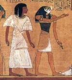 Horus holding the eternal life represented by an ankh while leading the dead to the afterlife. Papyrus of Ani.