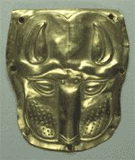 A 5th c. BC gold adorned wolf's face used as the adornment of a wood vessel.